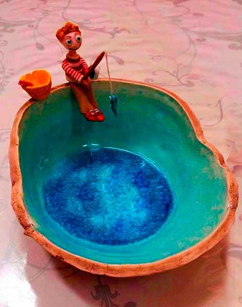 figura de cerámica artística de pescador