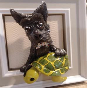 perro modelado en el taller de cerámica